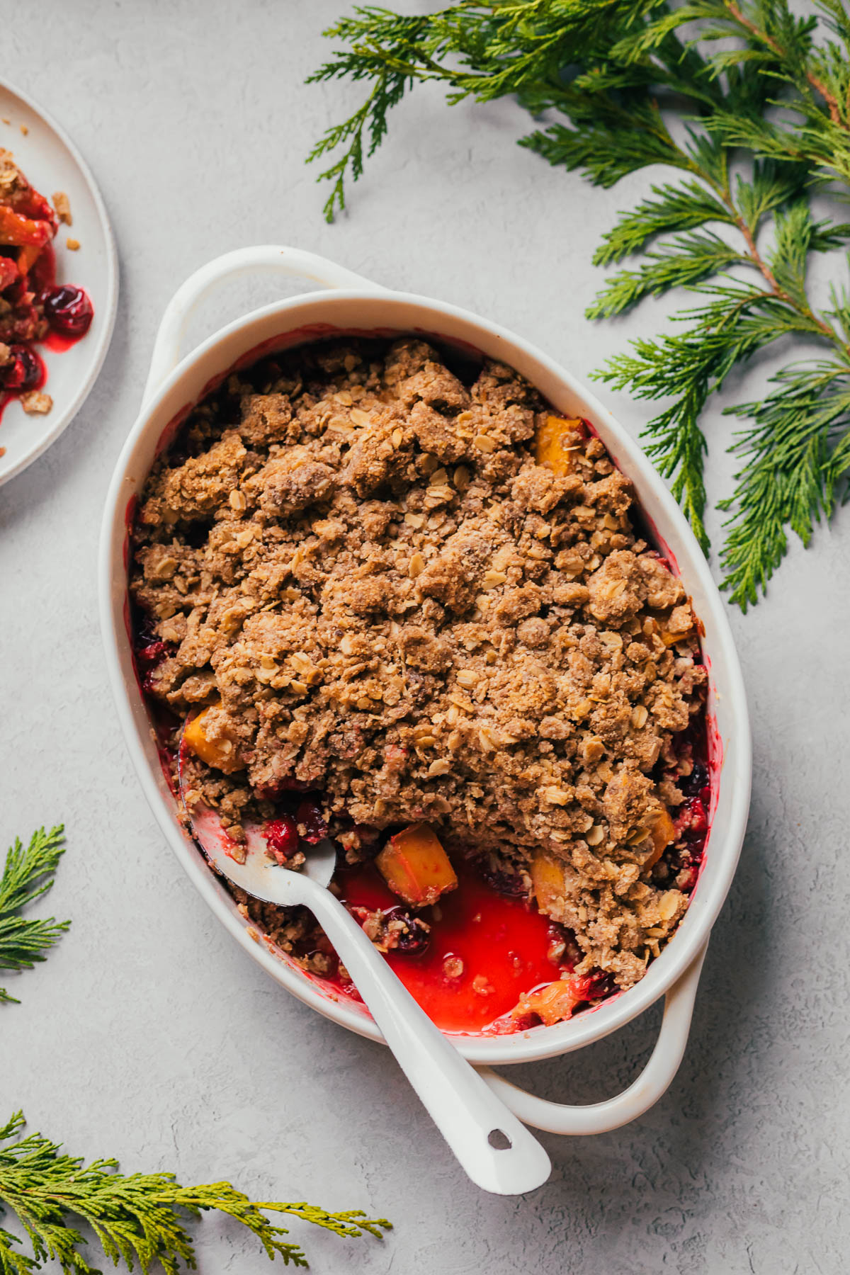 Cranberry crisp with a spoonful taken out.