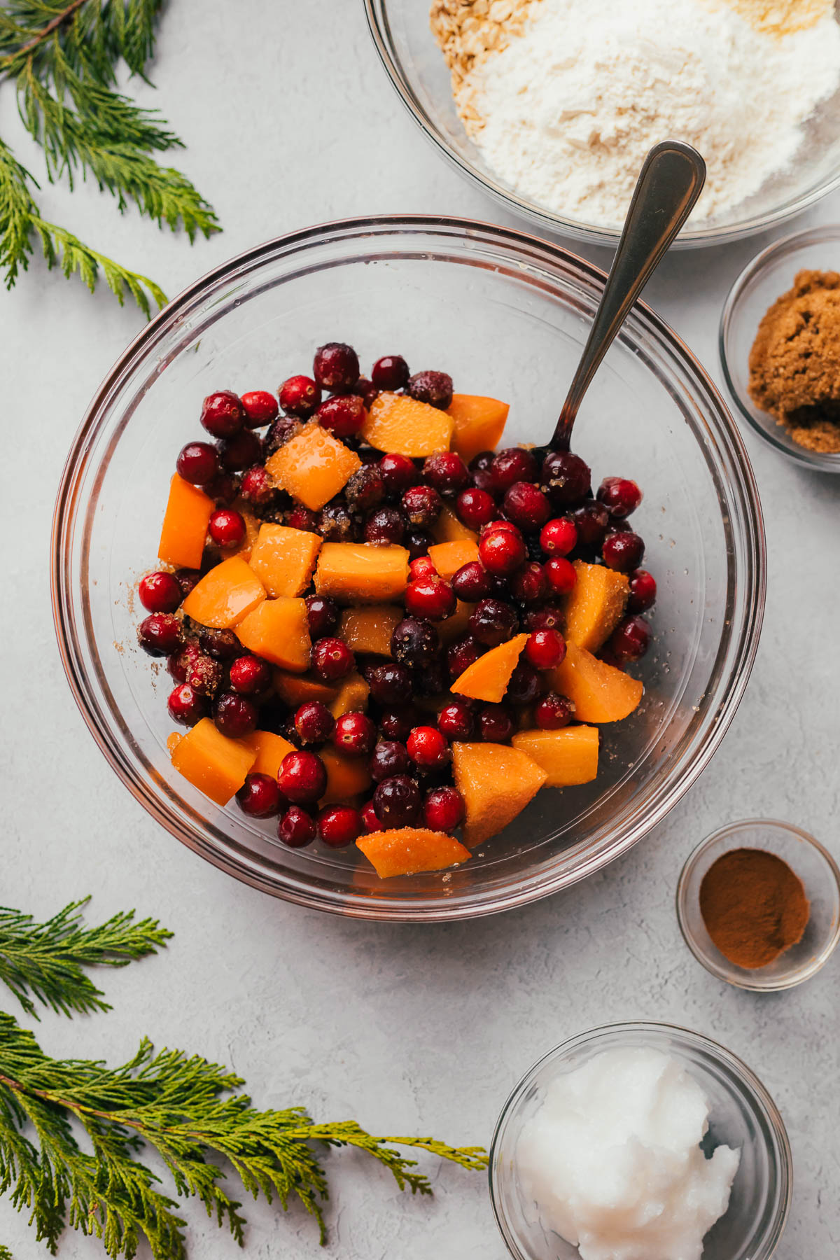 Cranberries and persimmons in a bowl.