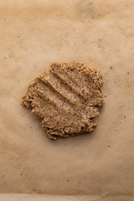 Dough disc placed on parchment paper.