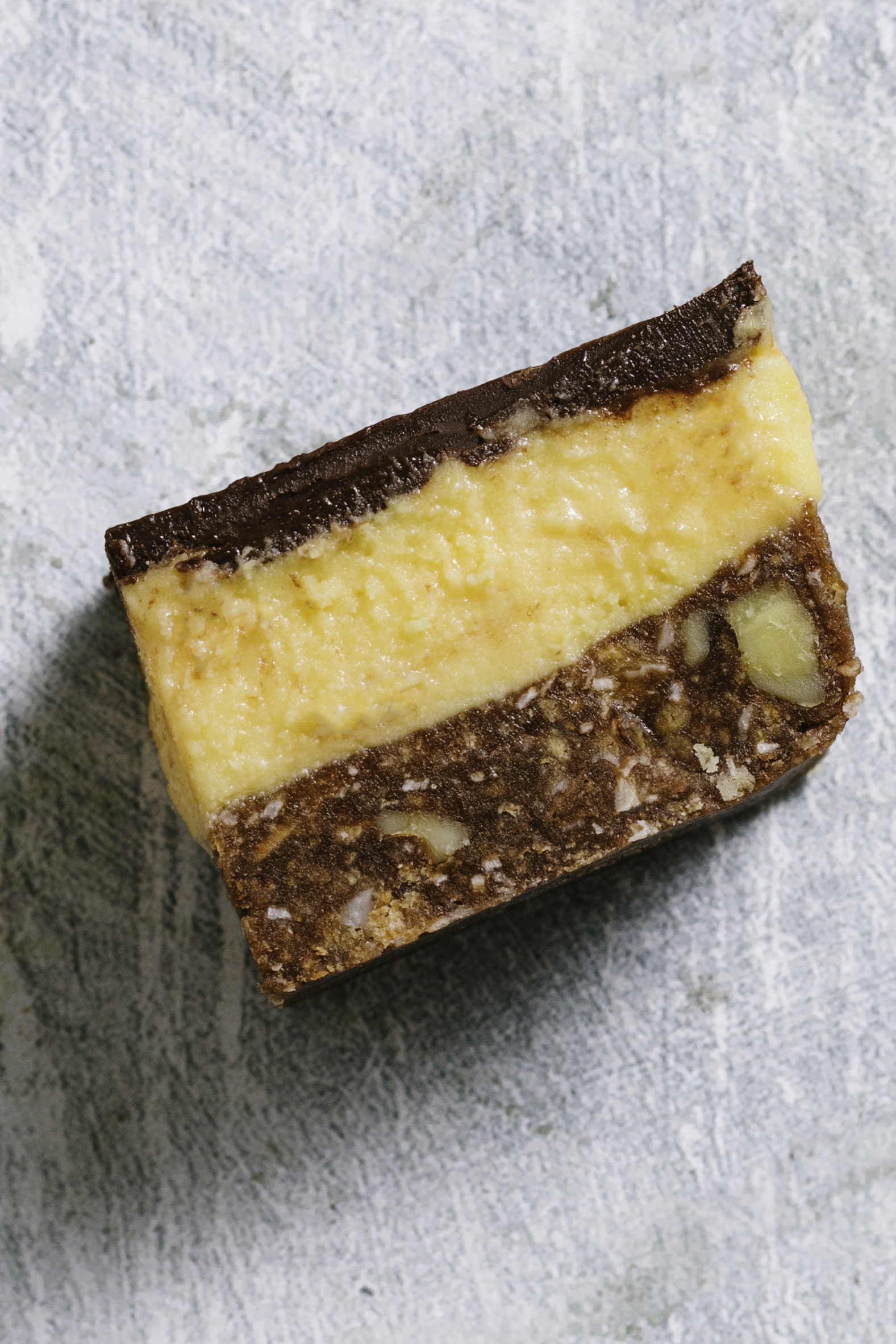 Close up of a nanaimo bar on its side.