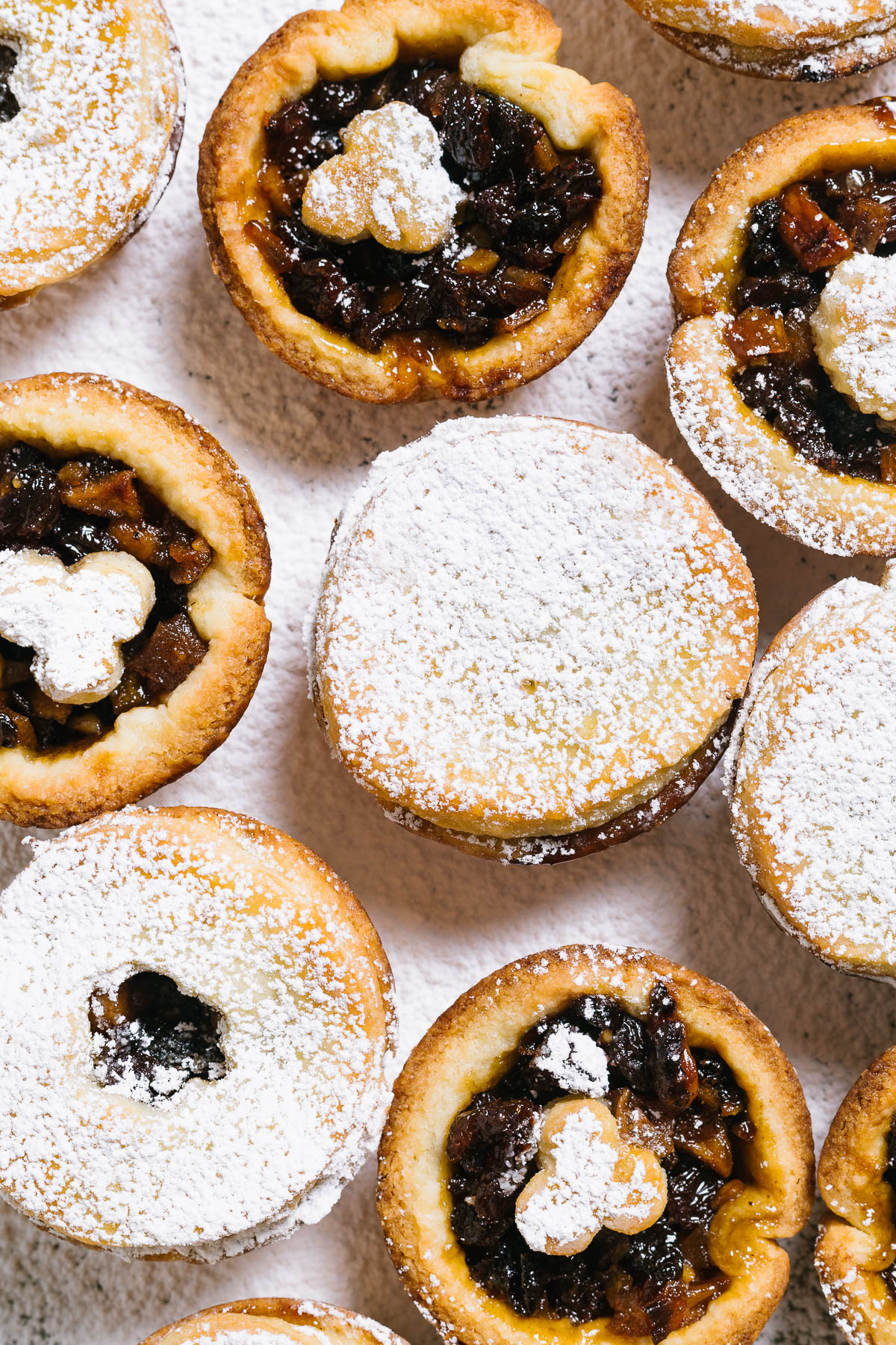 Several tarts, some fully covered with pastry and some decorated.