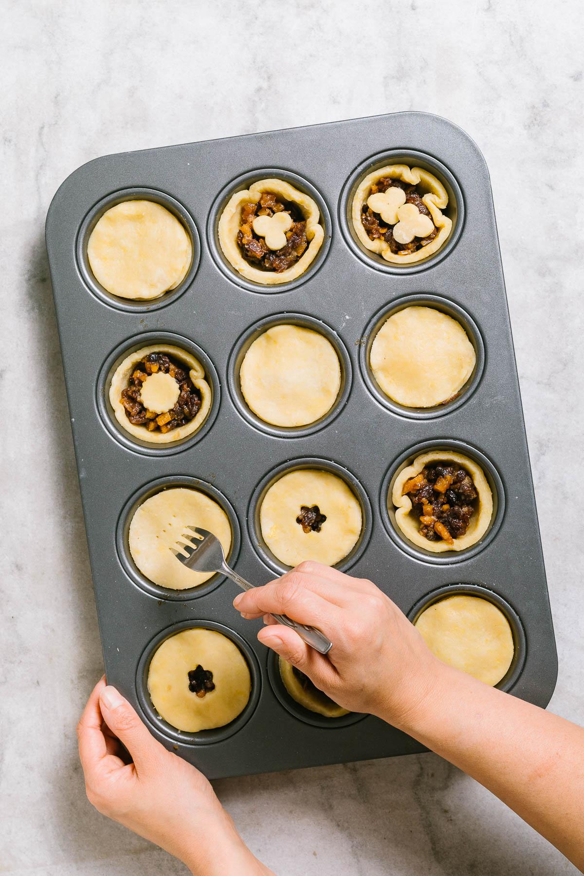Poking holes in tart casings.
