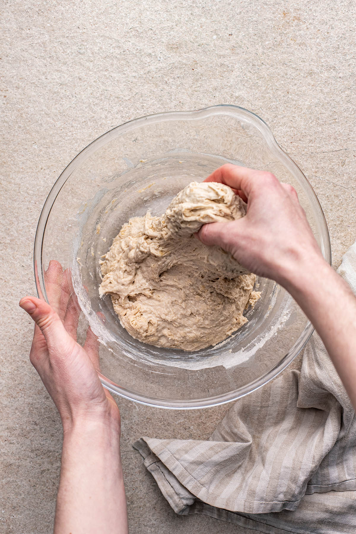 Stretching the dough.