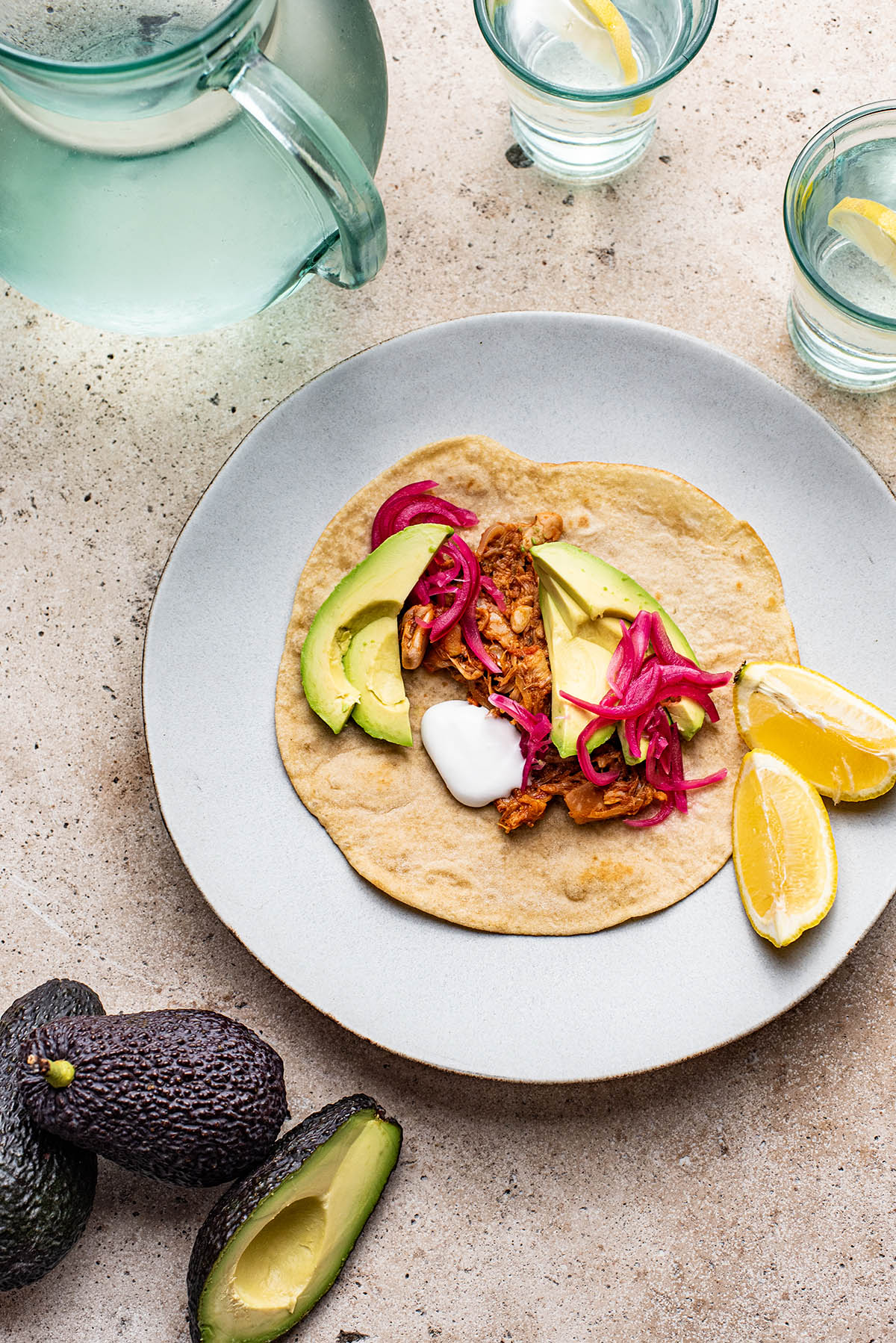 Jackfruit carnitas with avocado and pickled onions.