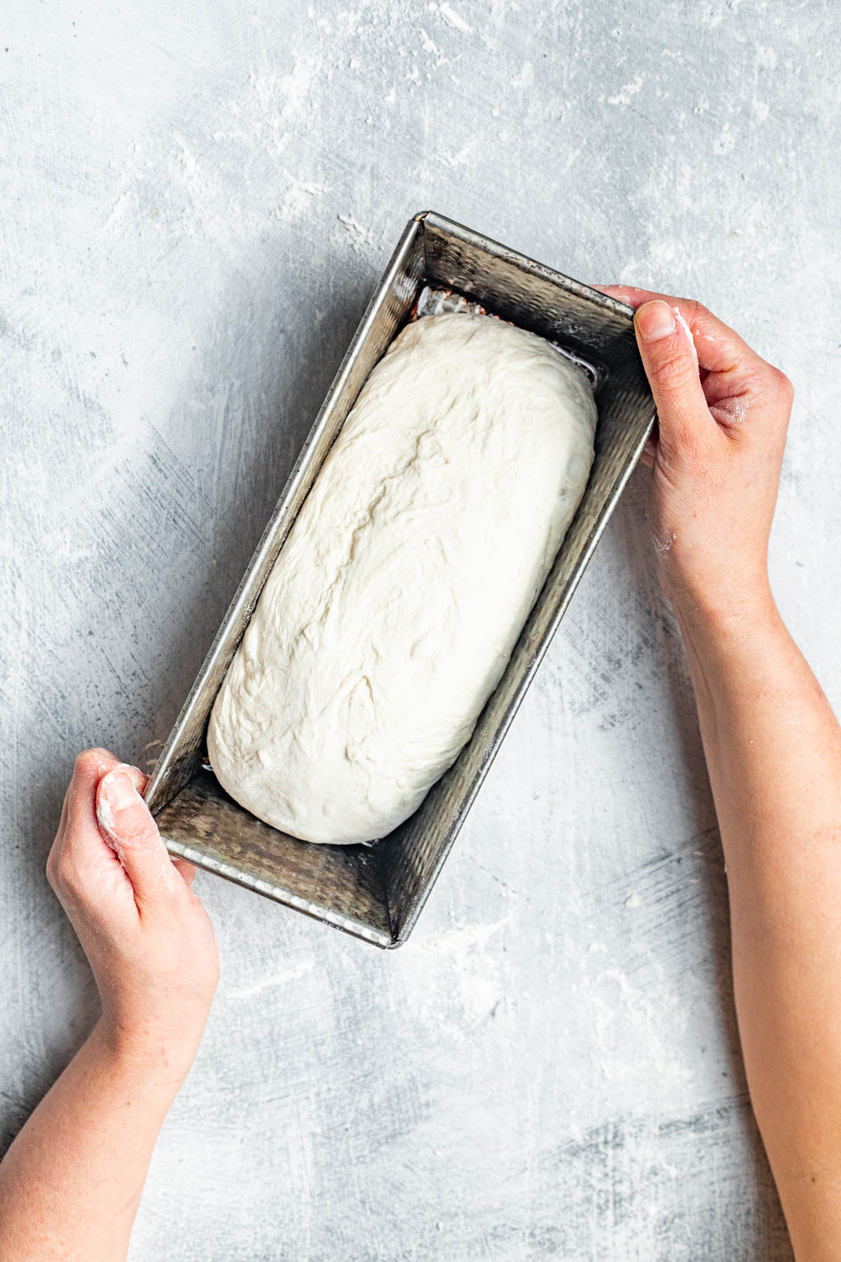 Shaped dough placed into a tin.