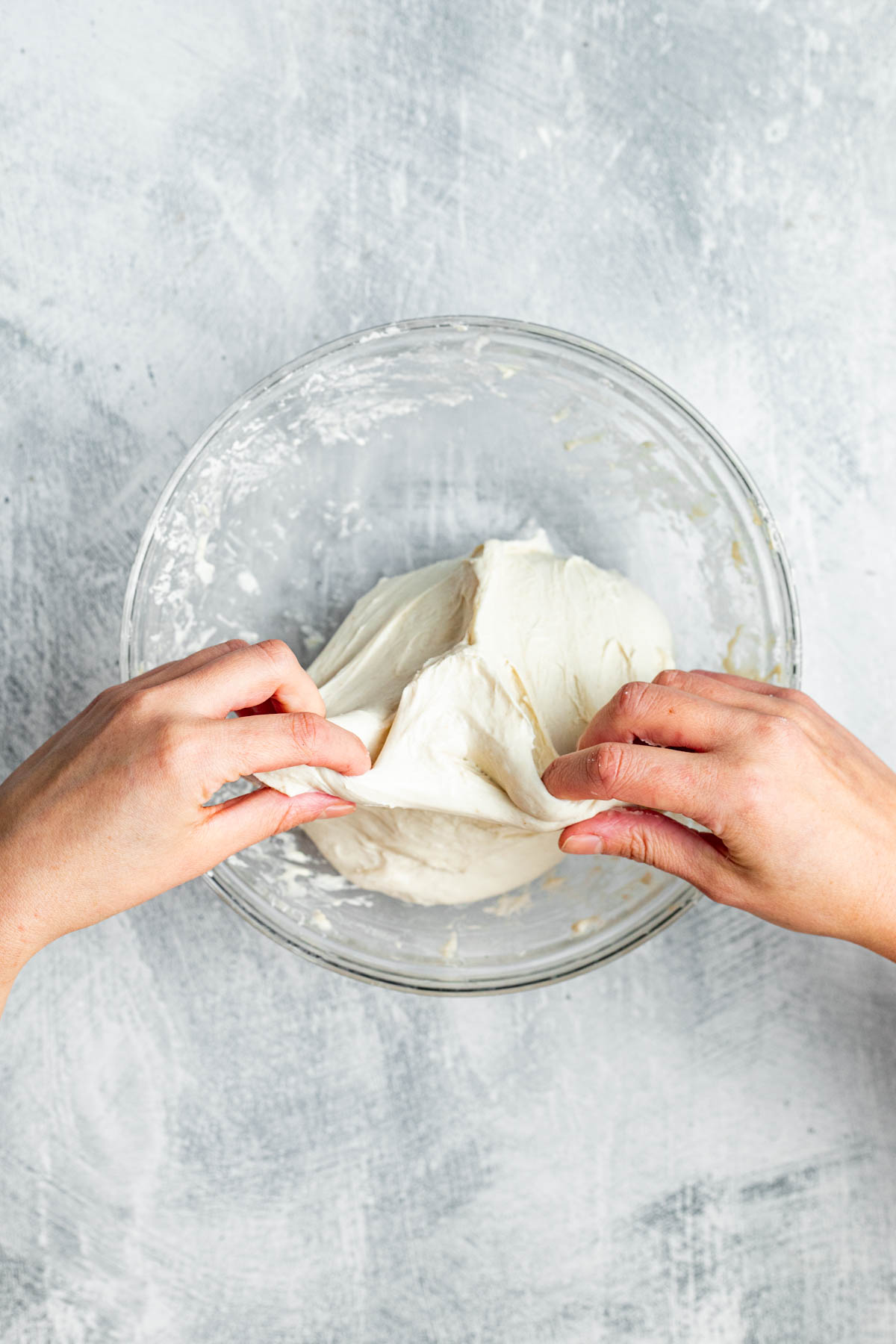Stretching and folding dough.