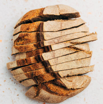 A loaf of sourdough bread, sliced, overhead shot.