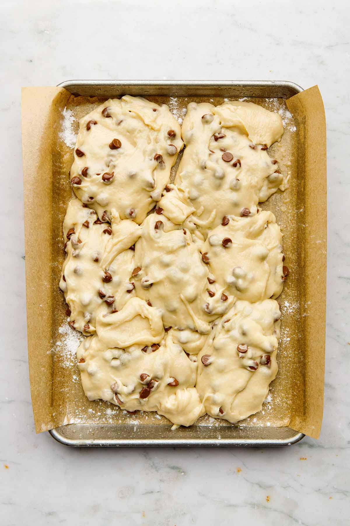 Dollops of cake batter in a pan.