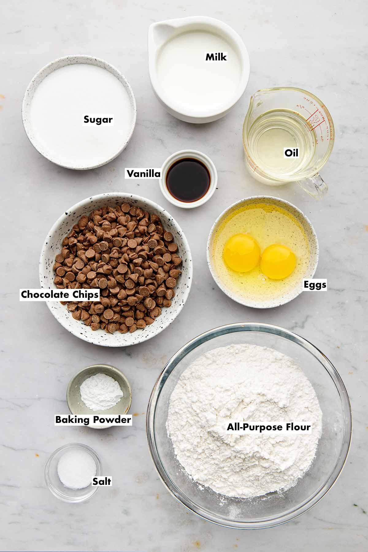 Ingredients to make a chocolate chip sheet cake.