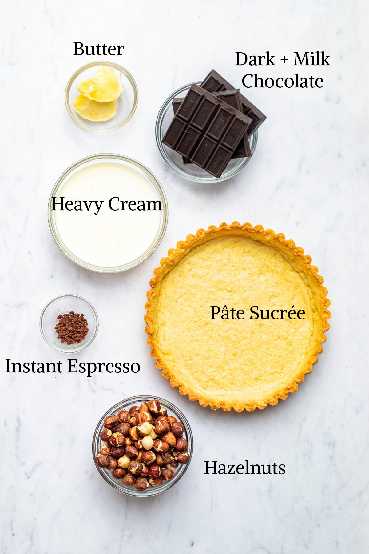 Ingredients to make a chocolate ganache tart.