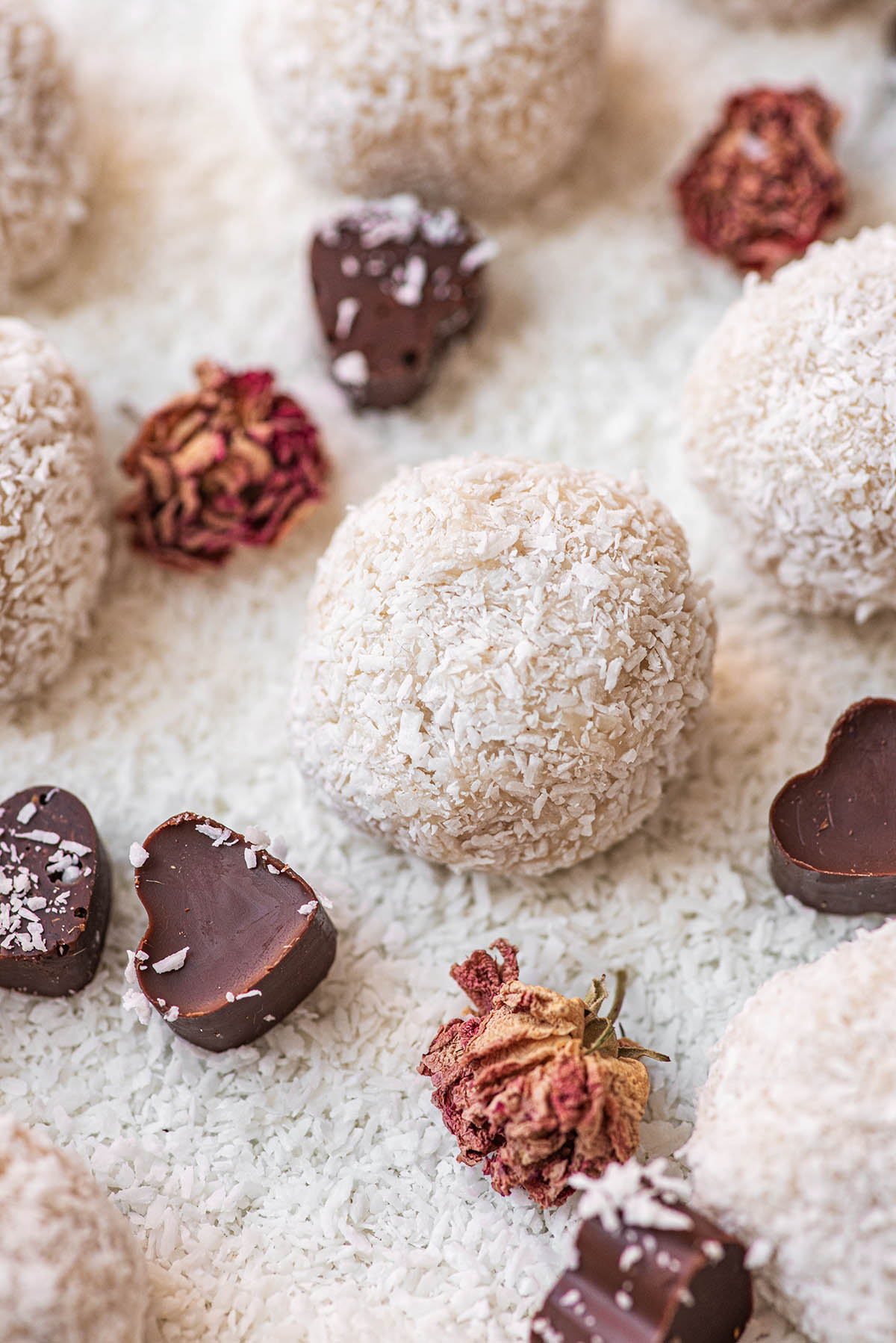 White chocolate truffles with shredded coconut and chocolate hearts.