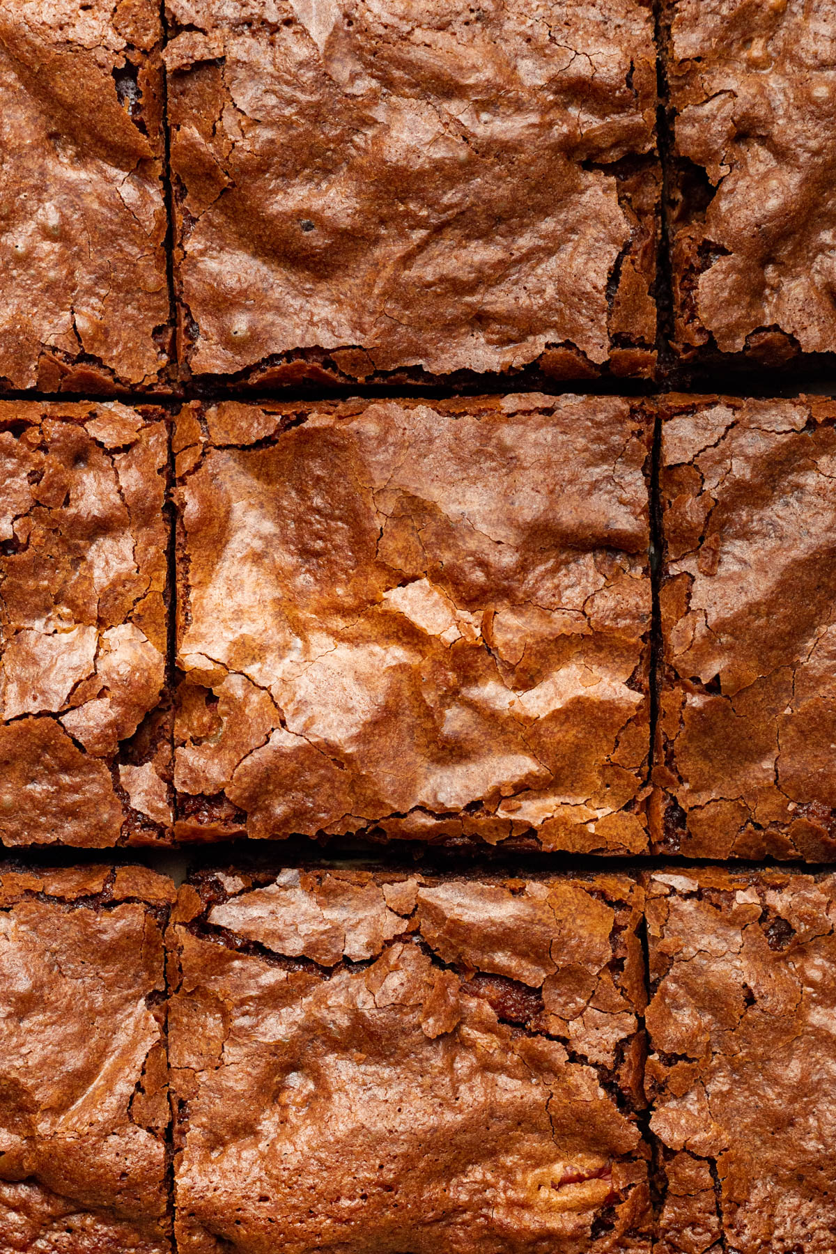 Sliced dairy-free brownies with crackly tops.