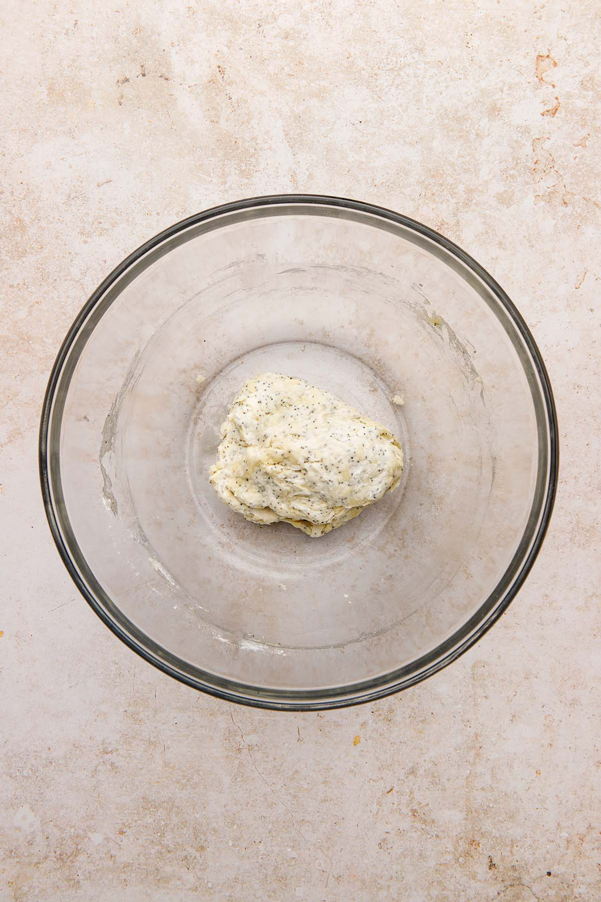 Dough in a glass bowl.