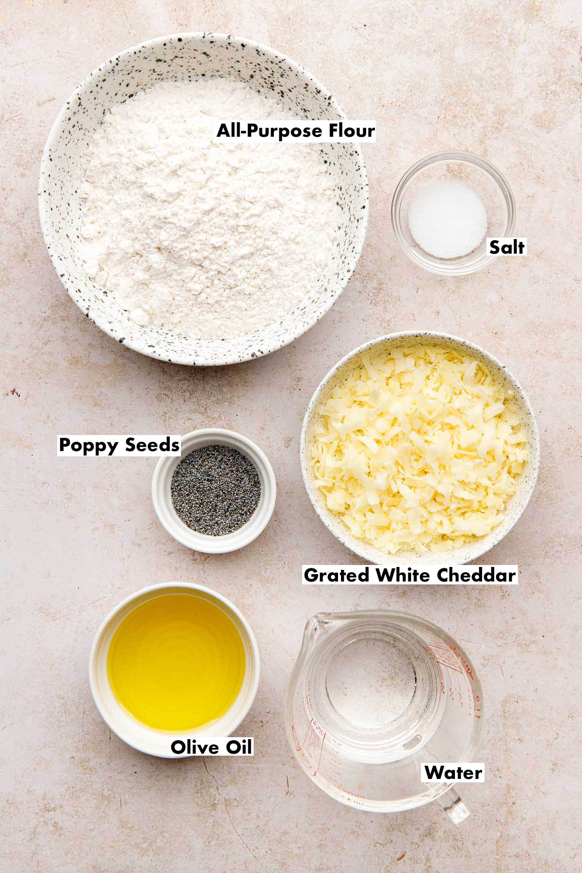 Ingredients to make white cheddar crackers with poppy seeds.