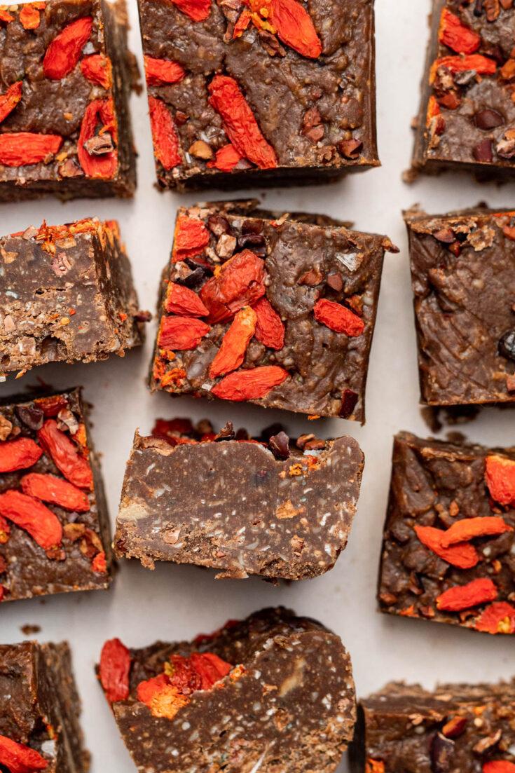 Small squares of vegan fudge with goji berries.