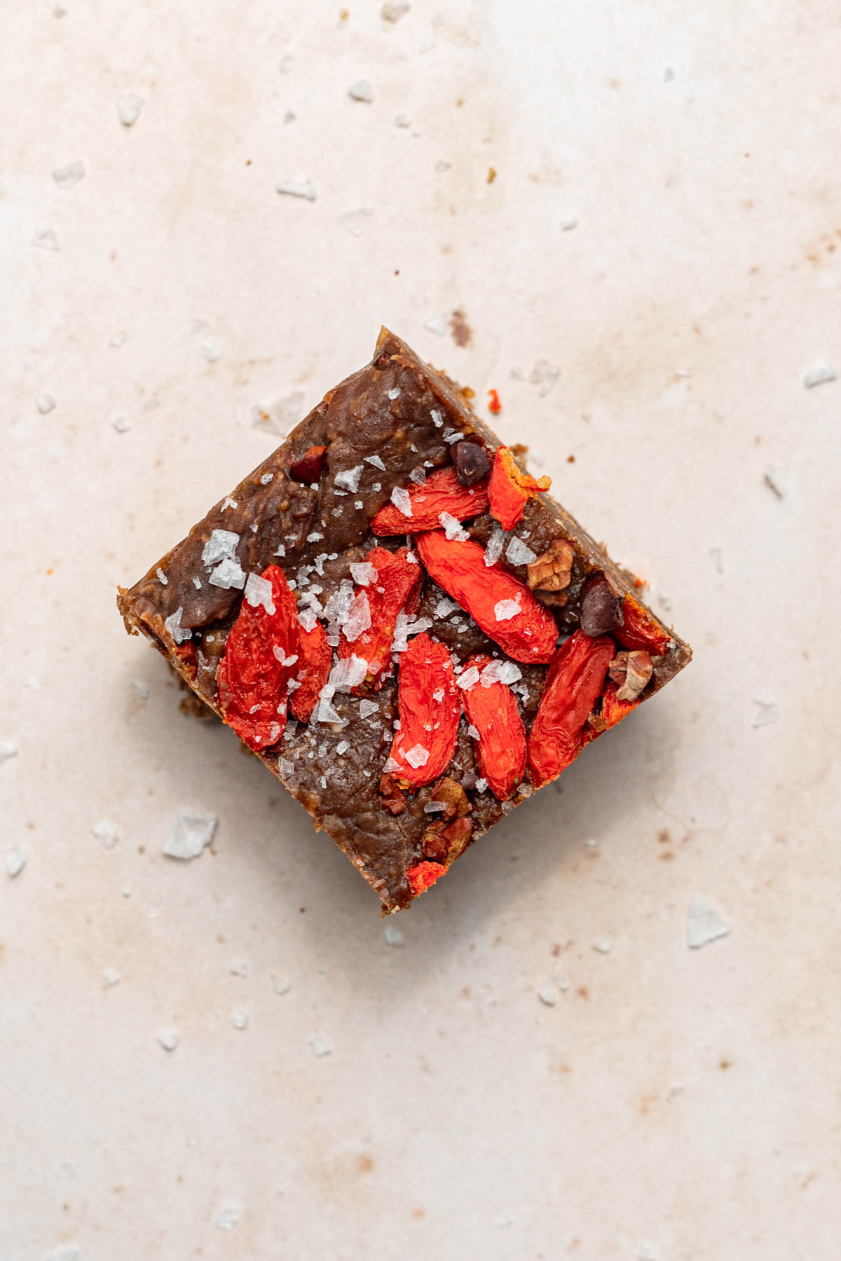 Close up of a square of fudge with flake salt on it.