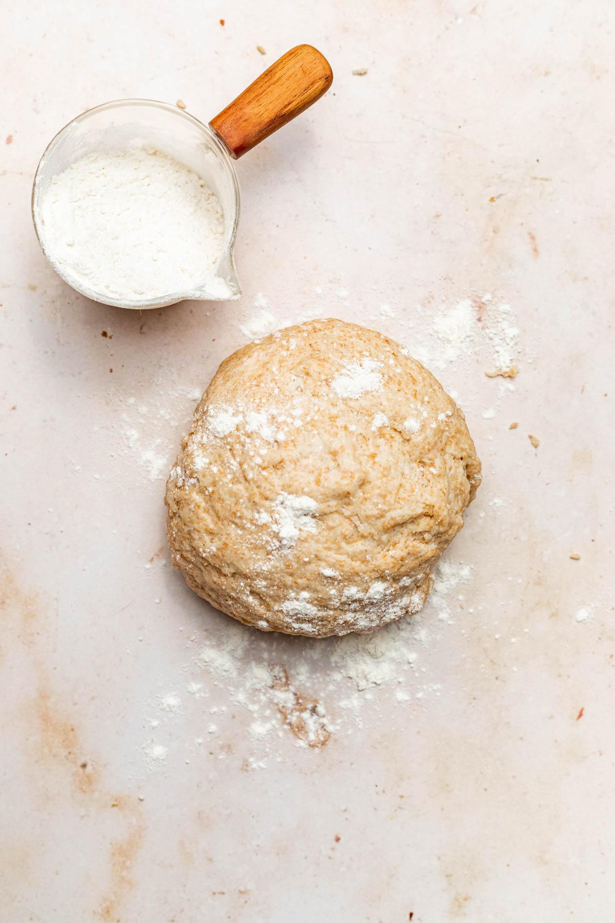 Cracker dough in a rough ball.