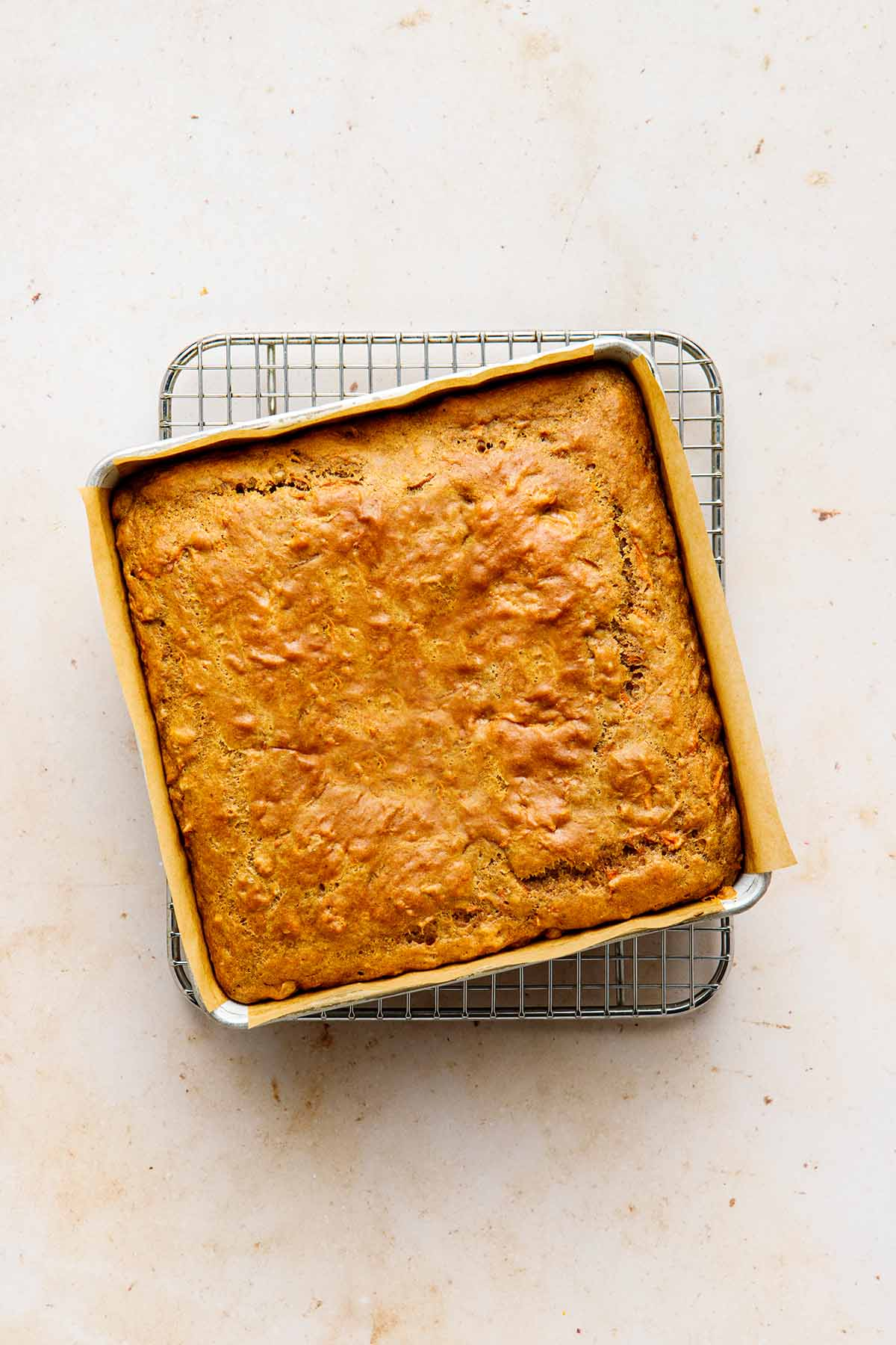 Baked cake on a cooling rack.