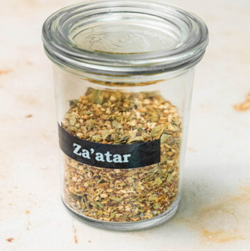 Jar of za'atar with a label.