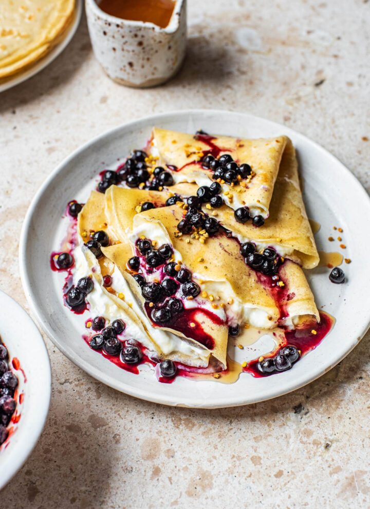 Folded crepes with yogurt and berries.