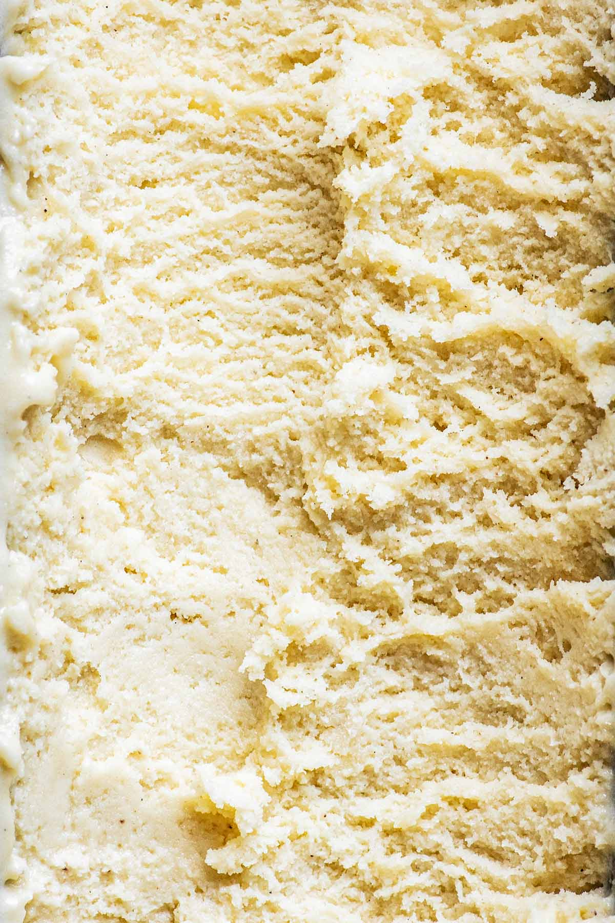 Close up of vanilla white chocolate ice cream, scoop marks.