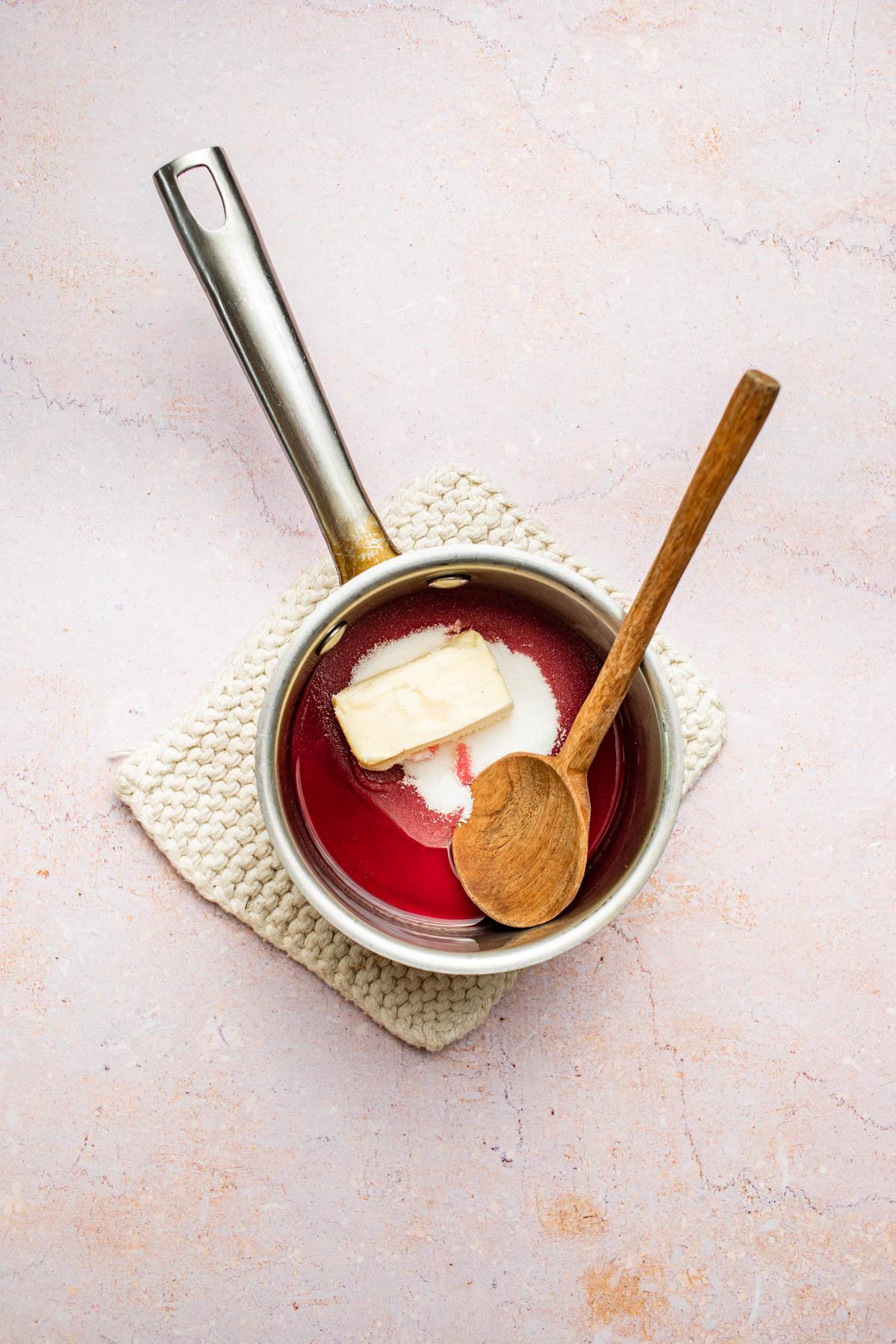 Butter, sugar, and liqueur in a saucepan.