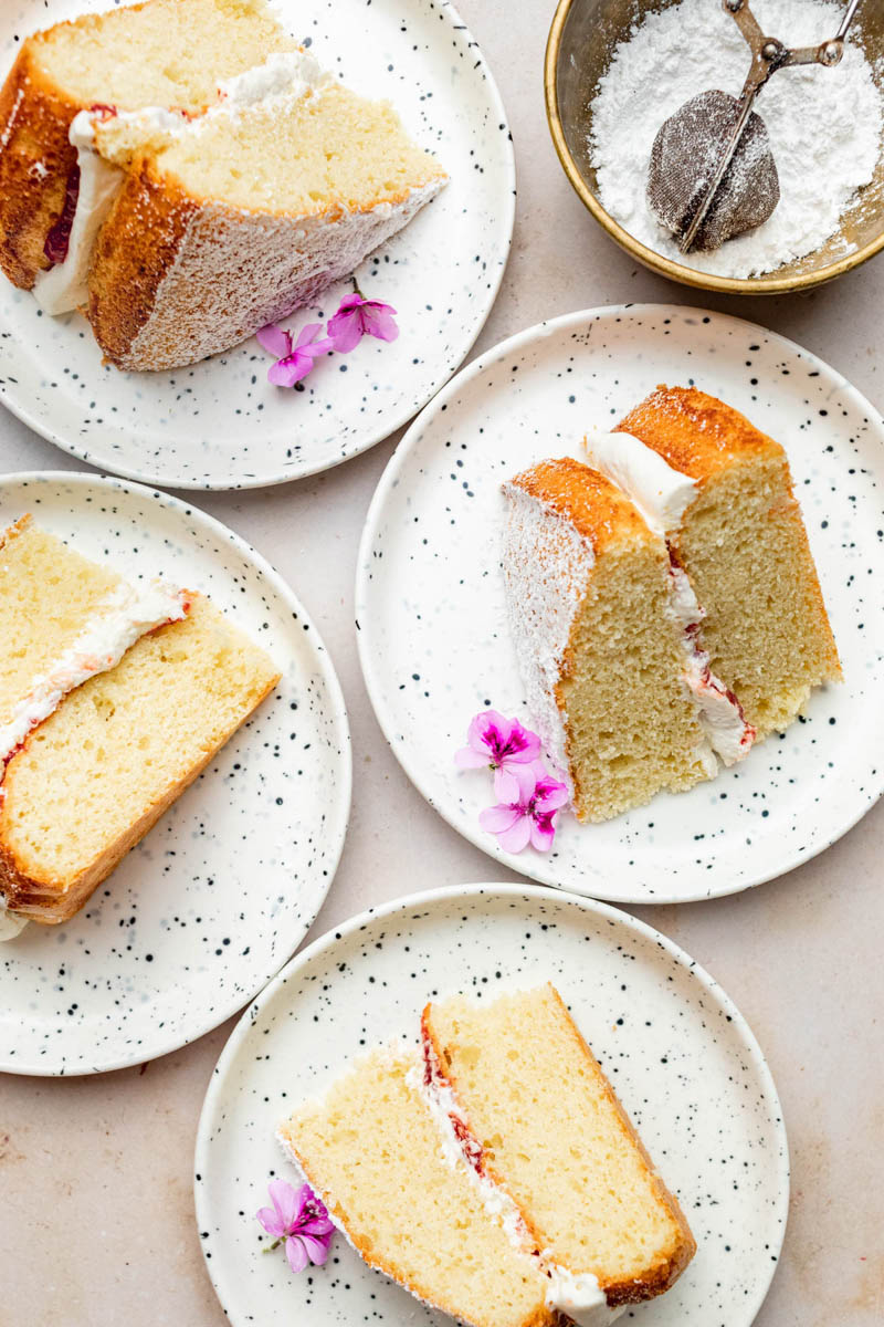 Four slices of cake on small plates, top down.