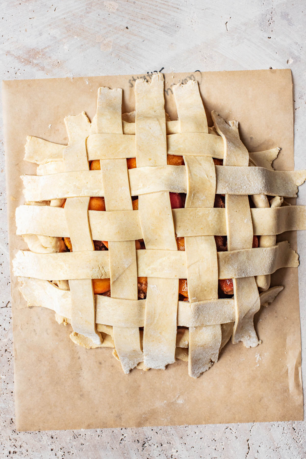 Lattice top for the pie before trimming and crimping.