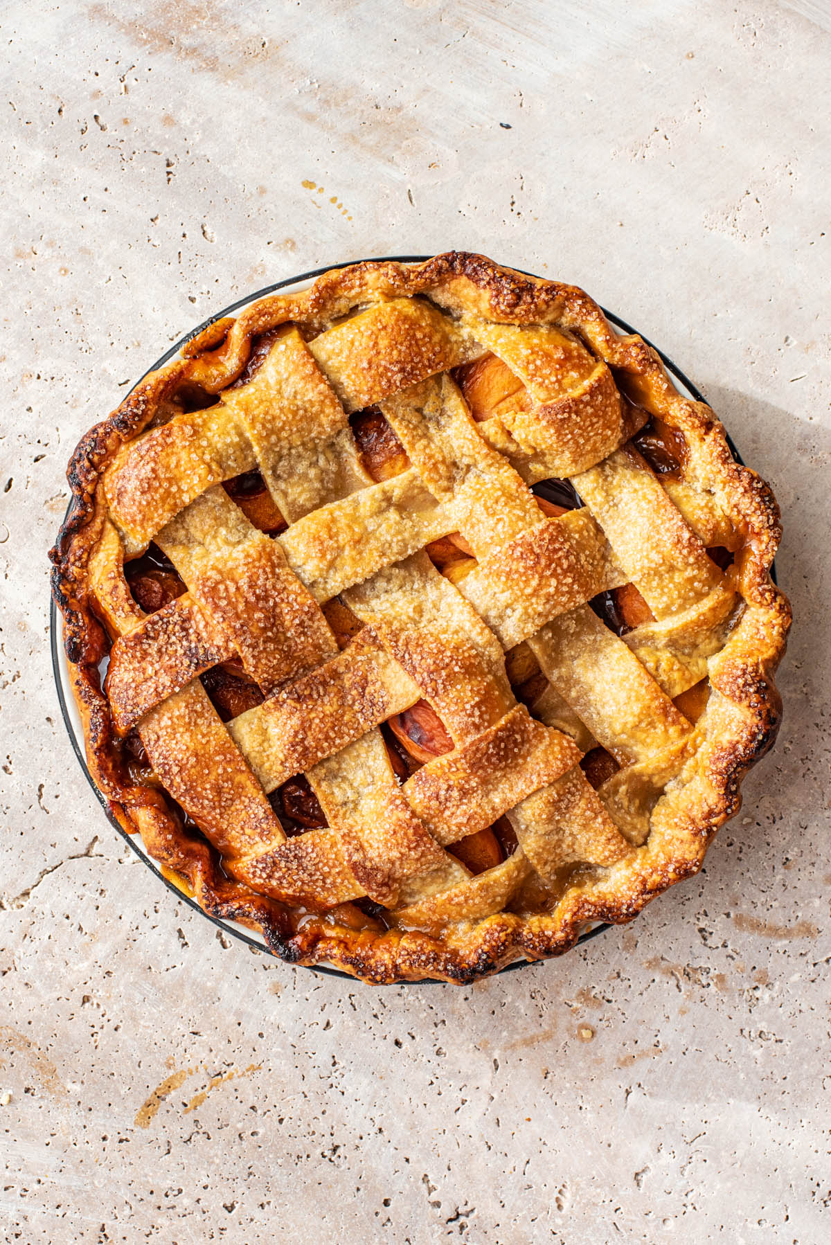 Top down view of apricot pie with a lattice crust.