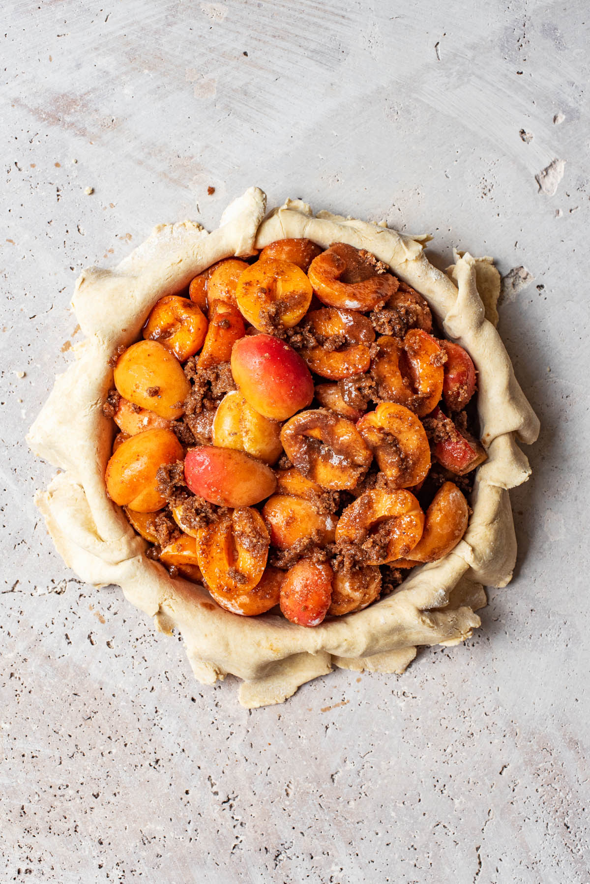 Apricot filling added to the pie crust.