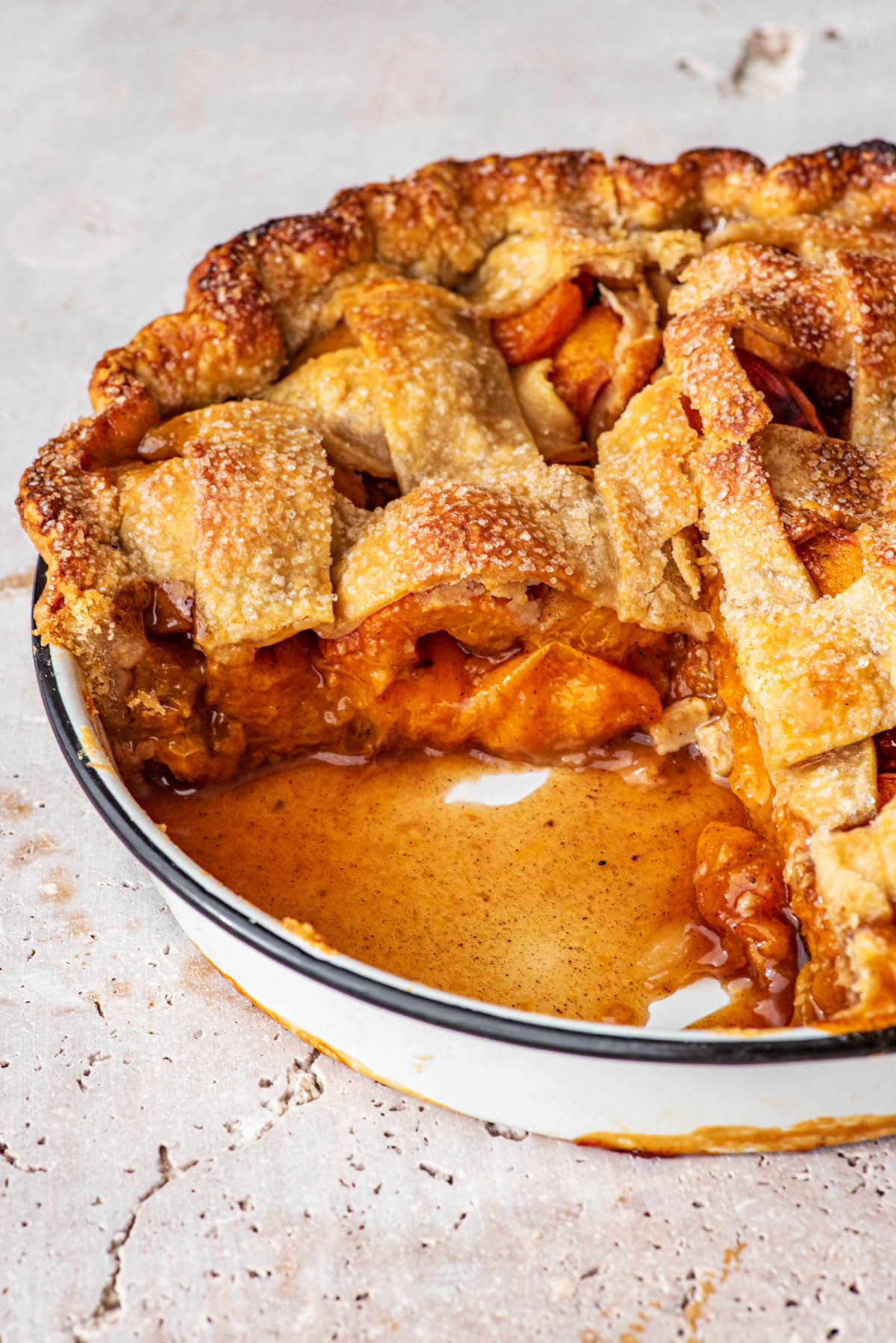 Pie in the tin with a slice removed.