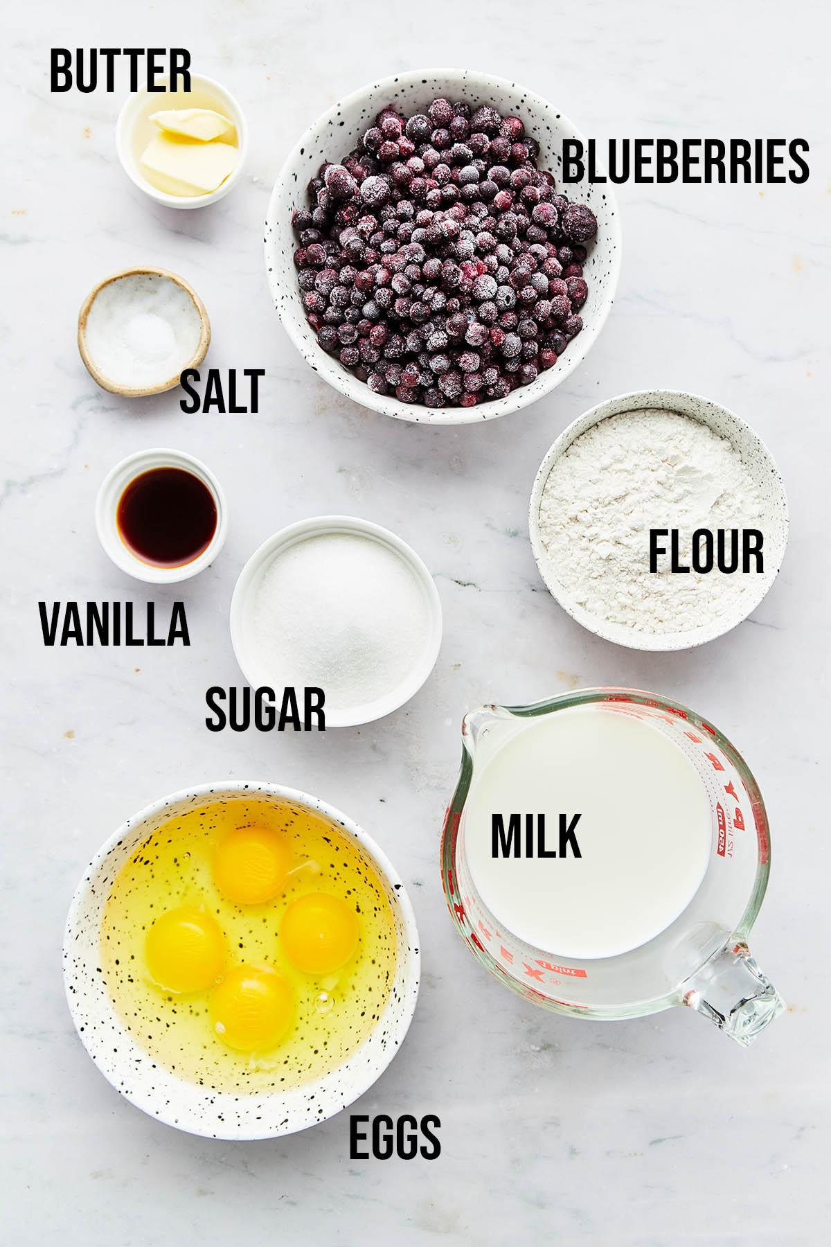 Ingredients to make blueberry clafoutis.