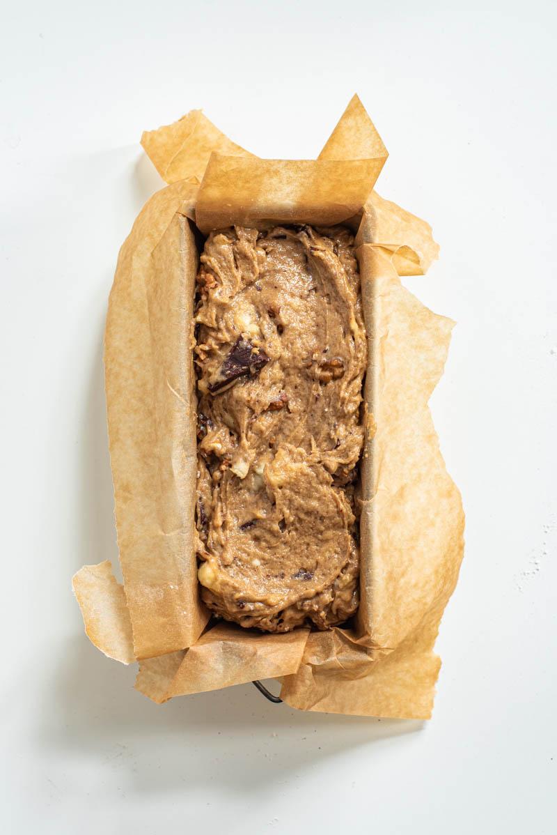 Banana bread batter in the tin ready to bake.
