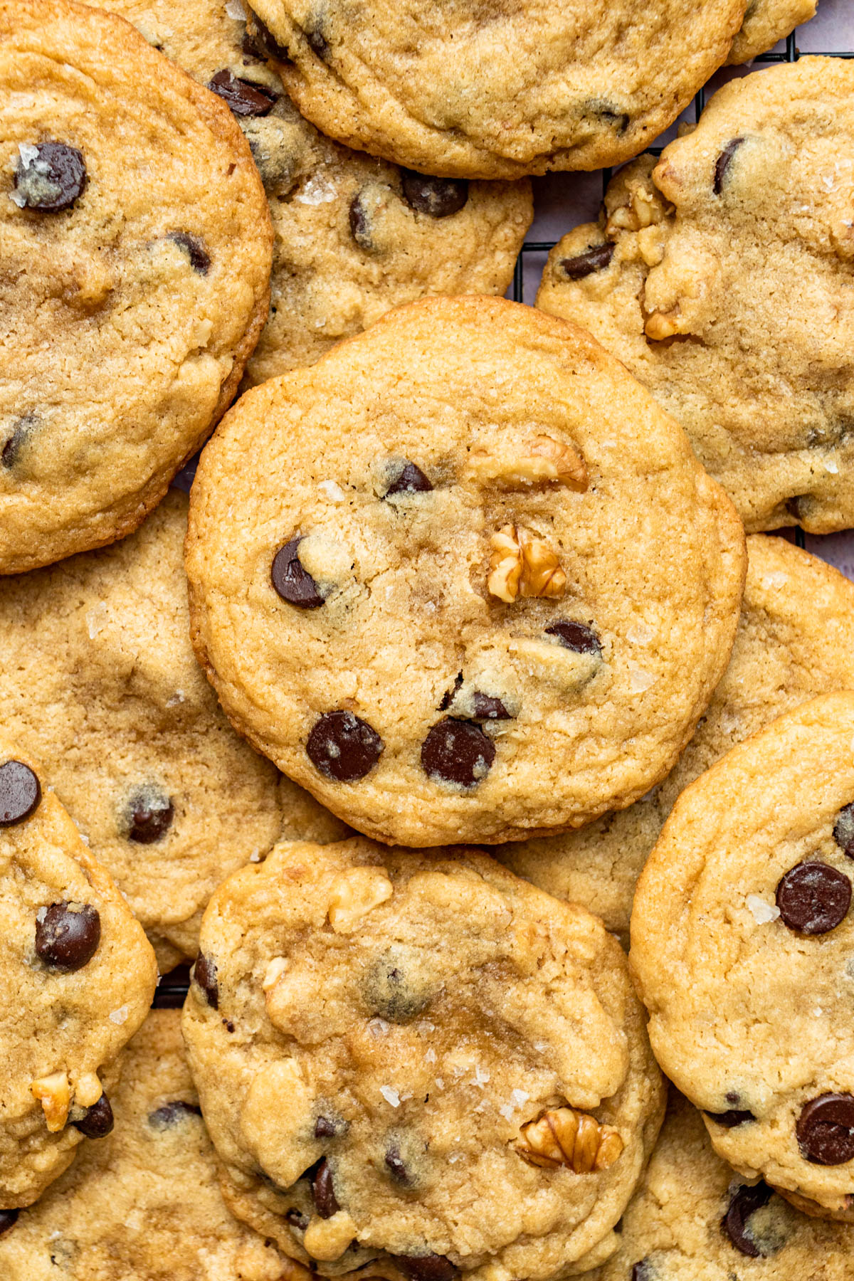 Overhead image of a pile of walnut chocolate chip cookies.