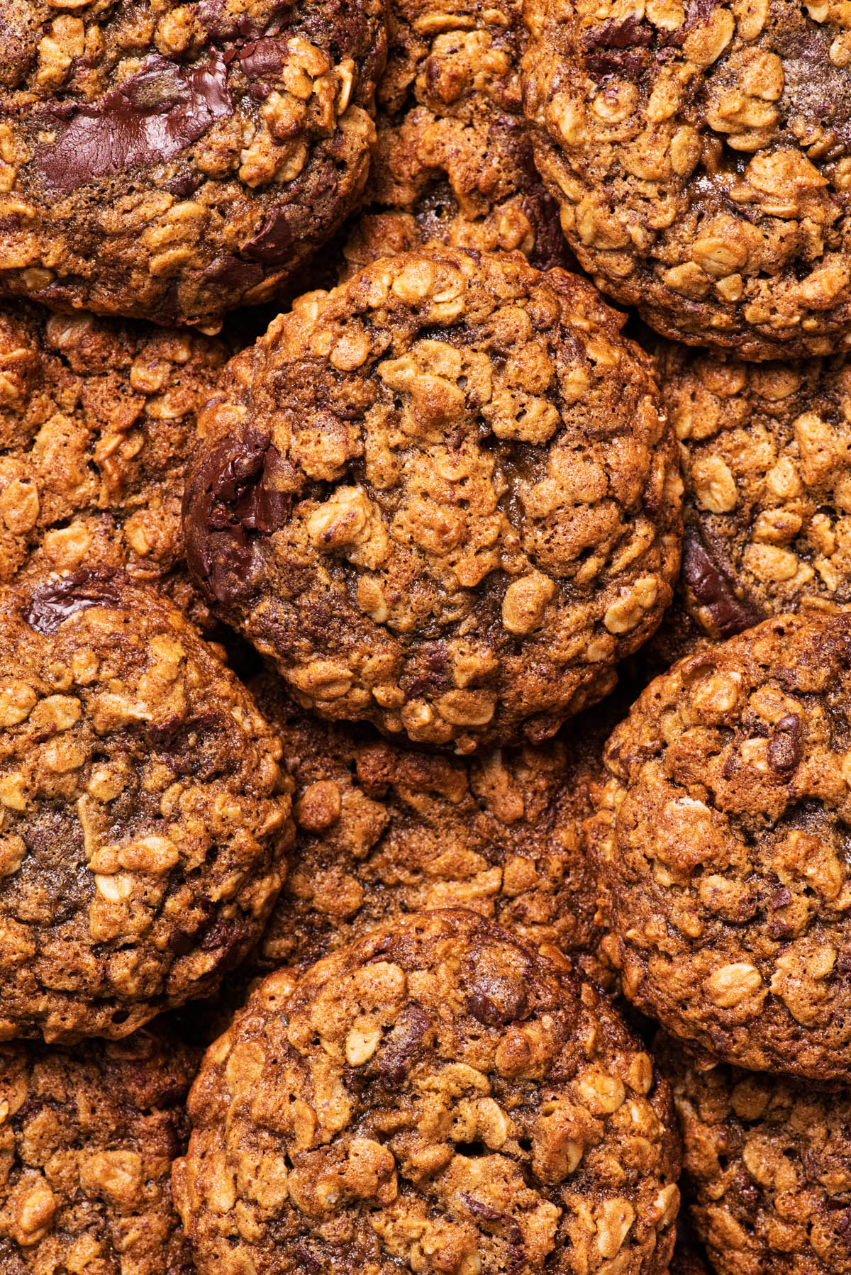 Close up of cookies piled on top of each other.